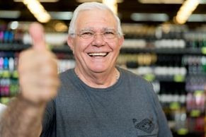 A senior Edmonton man giving a thumbs-up